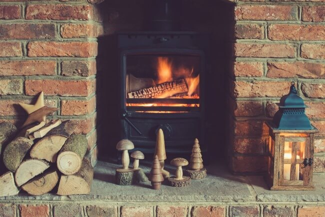 Shabby chic log burner with exposed brick fireplace