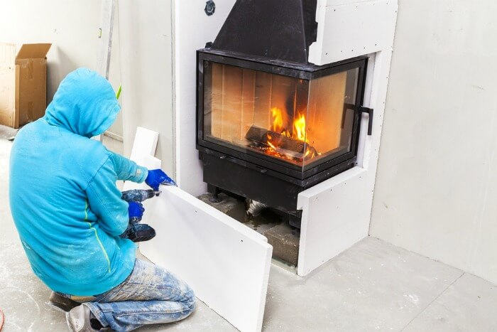 Man installing a fireplace