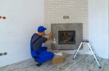 Fireplace installer at work