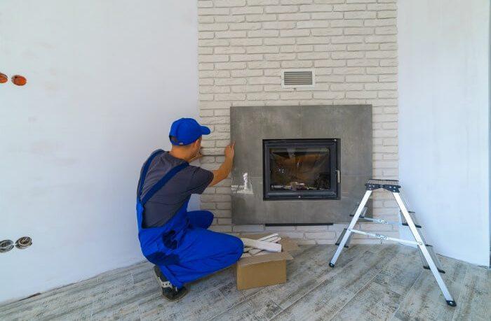 Fireplace installer at work