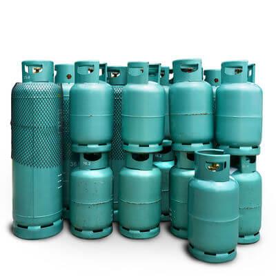 Different size green LPG propane tanks
