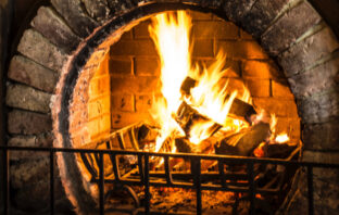 How to Improve the Efficiency and Heat Output of Your Open Fireplace